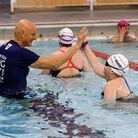 Duncan Goodhew encourages a young swimmer