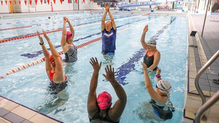 Duncan Goodhew helps swimmers in the pool
