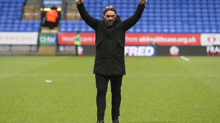 Norwich Head Coach Daniel Farke celebrates victory with the traveling Norwich fans at the end of the