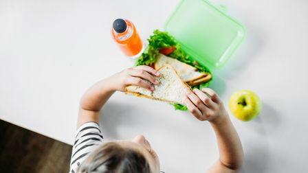 Free school meals - a child eating a sandwich