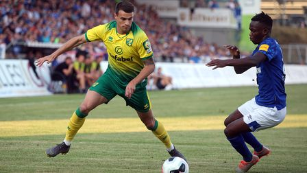 Philip Heise of Norwich and Rabbi Matondo of FC Schalke 04 in action during the Pre-season friendly