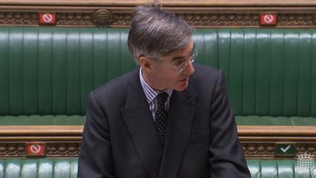 Social distancing markers can be seen behind Leader of the House of Commons Jacob Rees-Mogg as he sp