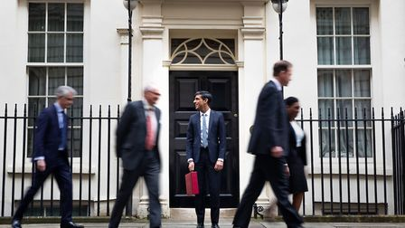 Chancellor Rishi Sunak outside 11 Downing Street before heading to the House of Commons to deliver h