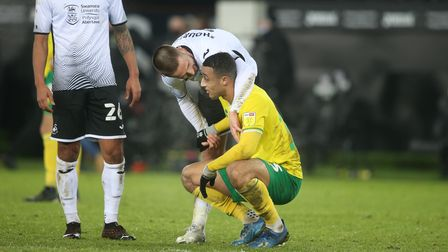 Conor Hourihane of Swansea City consoles Adam Idah of Norwich City at full time during the Sky Bet C