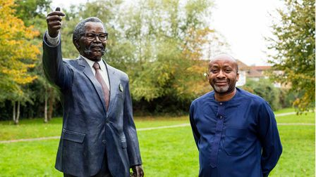 Cllr Joseph Ejiofor next to Oliver Tambo's statue in the former Albert Road Rec