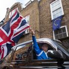 A London taxi driver waves a Union Jack flag in Westminster after the Brexit vote