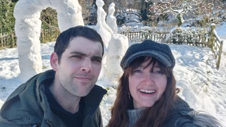 Devin Smith, and her boyfriend Mike Fisher, with snow sculptures behind them