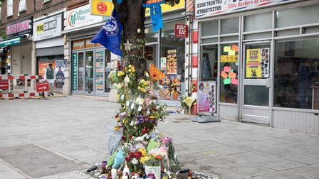 Floral tributes to Craig Small in Harrow Road where he was gunned down. Picture: Jonathan Goldberg
