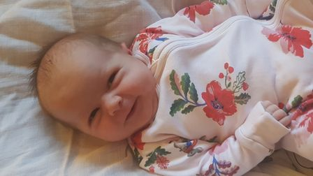 Baby in floral babygrow