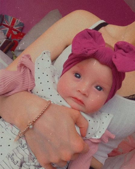 Baby in pink head bow