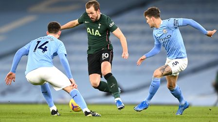 Tottenham Hotspur's Harry Kane (centre) battles for the ball with Manchester City's Aymeric Laporte