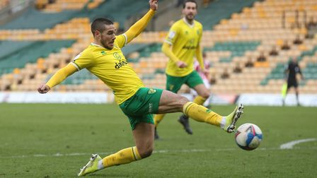 Emiliano Buendia of Norwich manages to get a toe to the ball to cross for Teemu Pukki of Norwich to