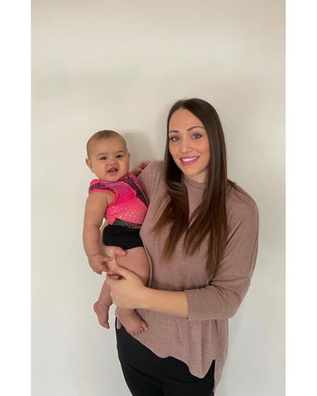 Becky Hambling with baby Myla in her mini leotard