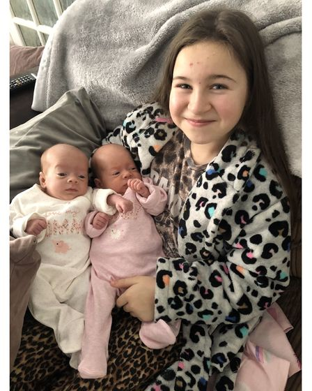 Big sister Esmae with Macy and Darcy Wilder
