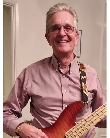 John Bobin plays bass on the fundraising track What a Kiss Will Do