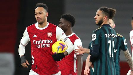 Arsenal's Pierre-Emerick Aubameyang (left) celebrates with the match day ball for his hat-trick afte