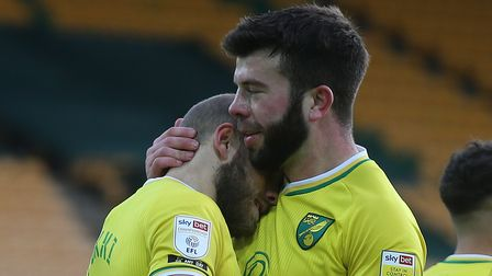 Teemu Pukki gets a pat on the back of the head from Norwich City captain Grant Hanley after his brace in a 4-1 win against...