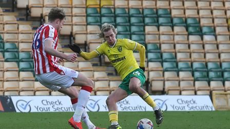 Harry Souttar of Stoke City and Todd Cantwell of Norwich in action during the Sky Bet Championship m