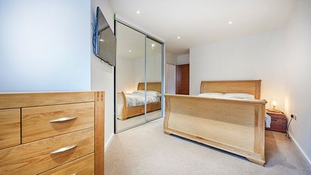 The spacious double bedroom has built in storage.