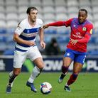 Queens Park Rangers' Lee Wallace (left) and Blackburn Rovers' Ryan Nyambe during the Sky Bet Champio