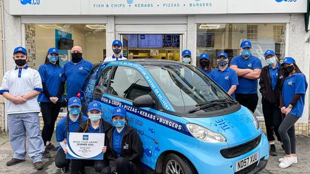 The Blue Fish Co team outside the fish and chip shop with their car