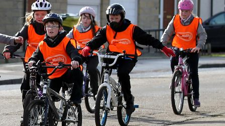 EMABARGOED TO 0001 MONDAY MARCH 25 Undated file photo of children riding their bicycles. A growing n