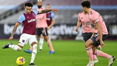West Ham United's Jesse Lingard (left) attempts a shot on goal during the Premier League match at th