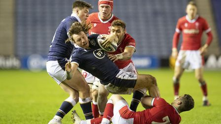 Scotland's Hamish Watson is tackled by Wales' Kieran Hardy
