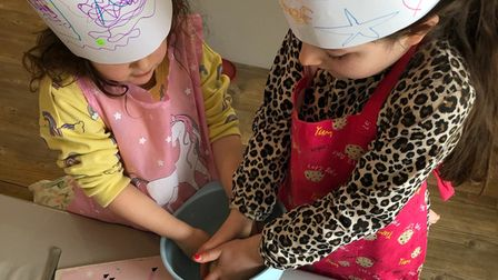 Two children mixing ingredients