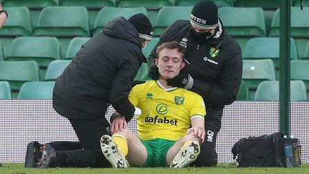 Oliver Skipp of Norwich requires treatment for a knock to the head that eventually sees him leave th