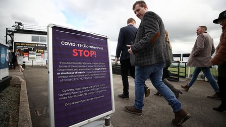 A sign notifying people about Coronavirus at Uttoxeter Racecourse. Photograph: Tim Goode/PA.