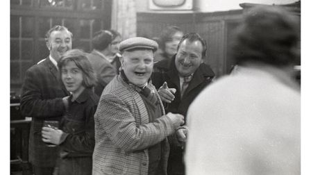 Smiling faces at The Duke of Gloucester pub in 1974