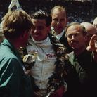 Jim Clark (middle) with designer, engineer and Lotus founder Colin Chapman (right). Picture: Bob D'O