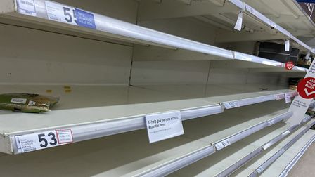 Supermarket shelves have been stripped as people panic buy in preperation for quaratine. Picture: Su