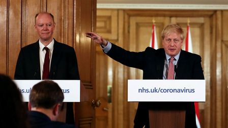 Prime Minister Boris Johnson gestures as he speaks during a coronavirus news conference inside 10 Downing Street.