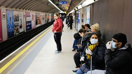People wearing face masks in King's Cross tube station in London. Photograph: Ian Hinchliffe/PA Wire