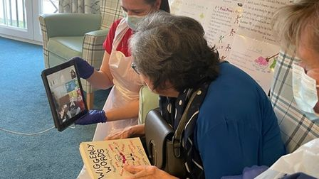 Joan Vicente reads her poems to the kids at Hopscotch Day nursery.
