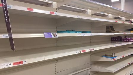 Supermarket shelves stripped bare amid the coronavirus outbreak. Picture: Archant