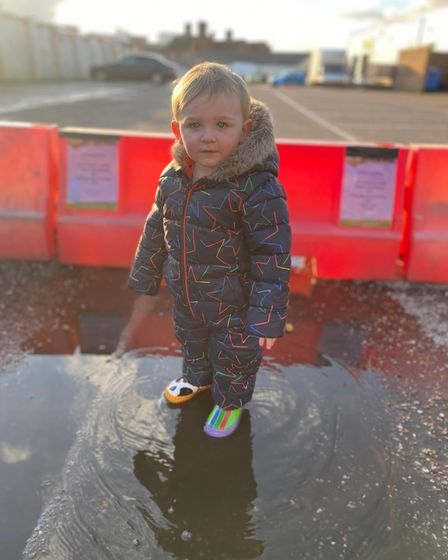 A child from Twizzle Tops nursery enjoying the puddle jump