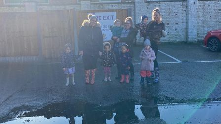 Parents and children at the puddle jump by Twizzle Tops nursery