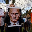 Demonstrators hold up banners in front of the Russian embassy in The Hague, Netherlands