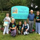 Sidmouth Fairtrade Group at the Sidmouth town sign