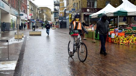Cyclists and pedestrians share the space on Narrow Way Hackney Central 09.02.21.