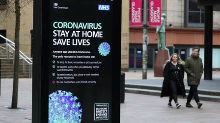 Coronavirus warnings on signs in Glasgow as the UK continues in lockdown to help curb the spread of