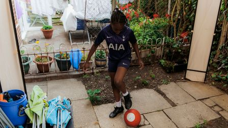 T'shaya Francis practices her football skills in the garden after school, 18th September, 2020. When