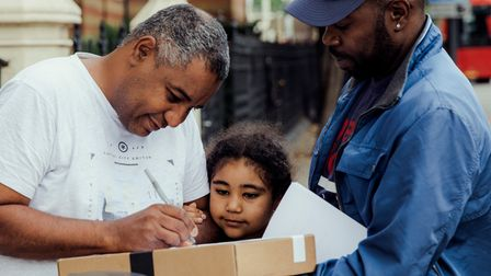 Andrew Gordon, a volunteer with Melissa's organisation Bridge The Gap - Families in Need, delivers a