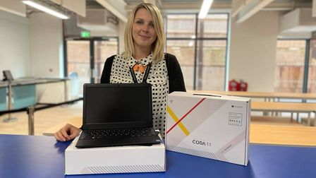 Assistant Principal Mrs Carr with laptops purchased with donations