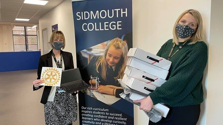 Mrs Parsons and Mrs Carr with Laptops purchased from donations from the Lions Club and Sid Vale Association