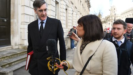 Leader of the House of Commons Jacob Rees-Mogg speaks to the media as he leaves the Cabinet Office i