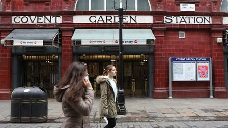 People walk past London's Covent Garden Station, which is one of up to 40 Underground stations that